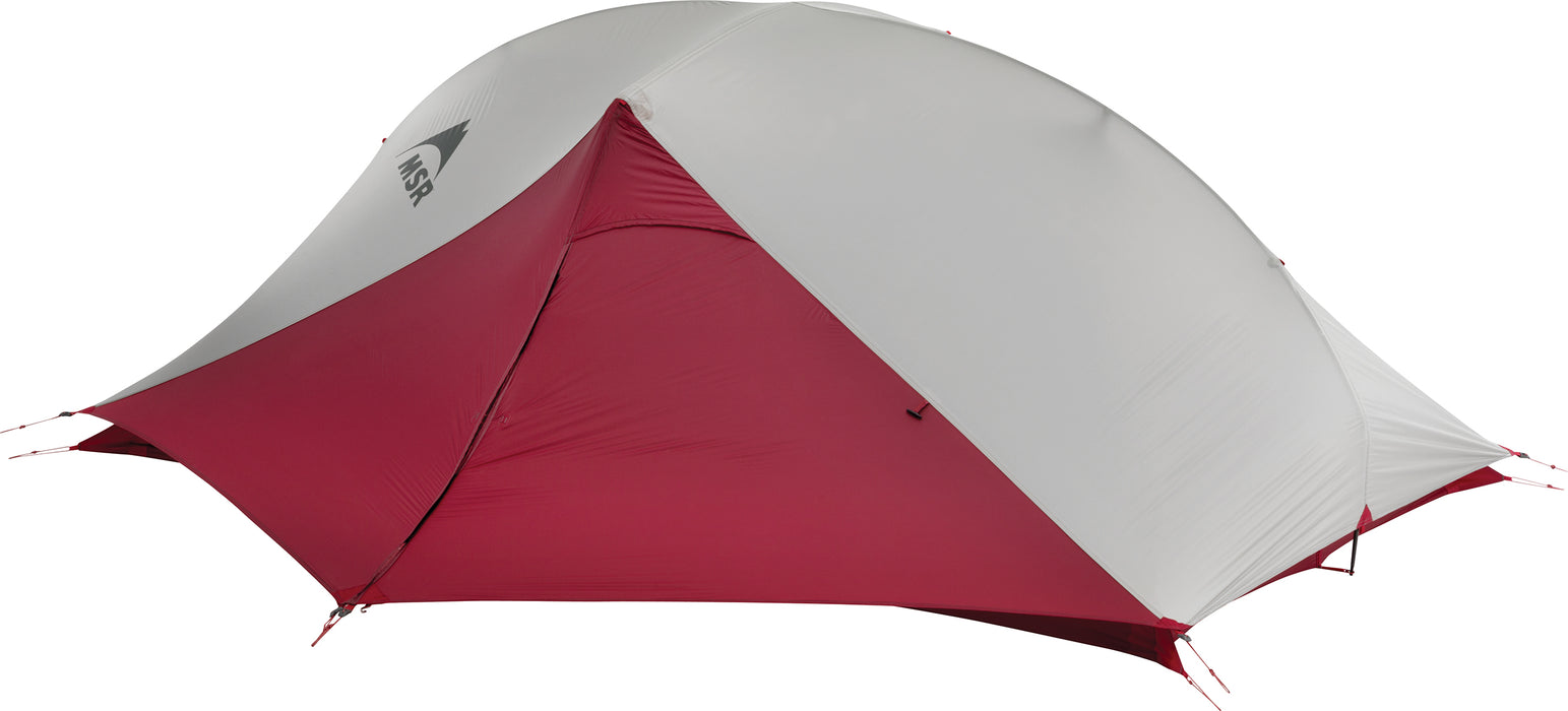 The weather cover of the MSR Carbon Reflex 2 Person tent in deep red and grey with the MSR logo printed in black on the middle of the tent.