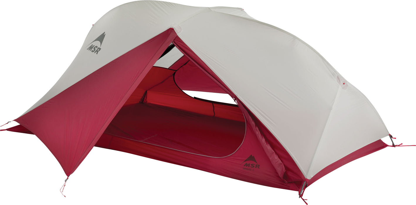 Freelight Ultralight 2 person backpacking pent in light grey and red showcasing the sheltered entry way.