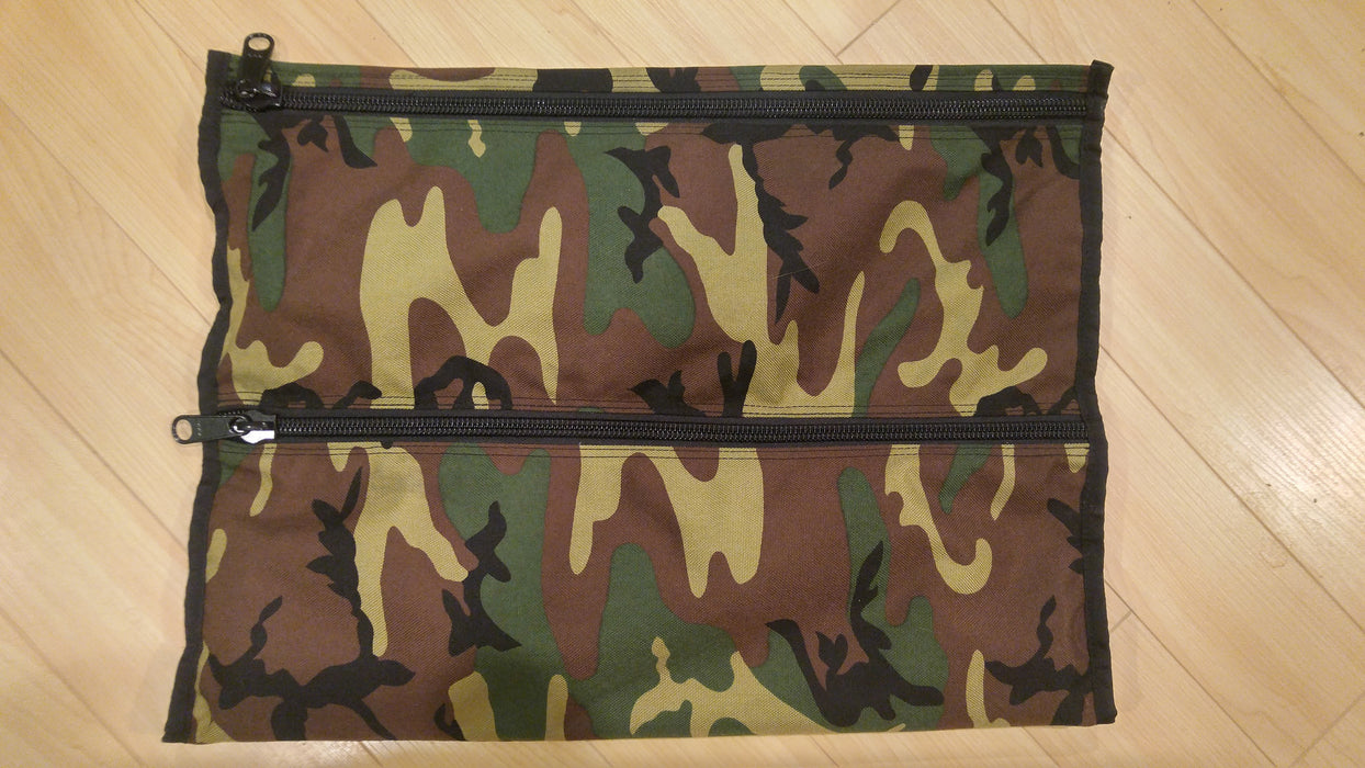Cordura mod for the Bug Out Roll, in an army camo on a maple hardwood floor.