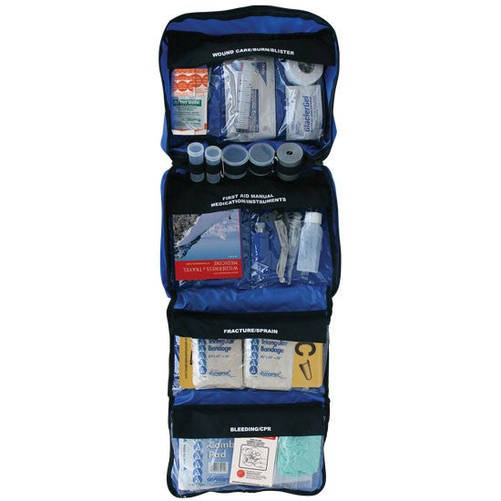 Backcountry Adventure Medical Kit with 4 compartments of medical supplies in blue with black covers labeled with 'wound care' 'first aid manual' 'fracture/sprain' and 'bleeding/cpr'.