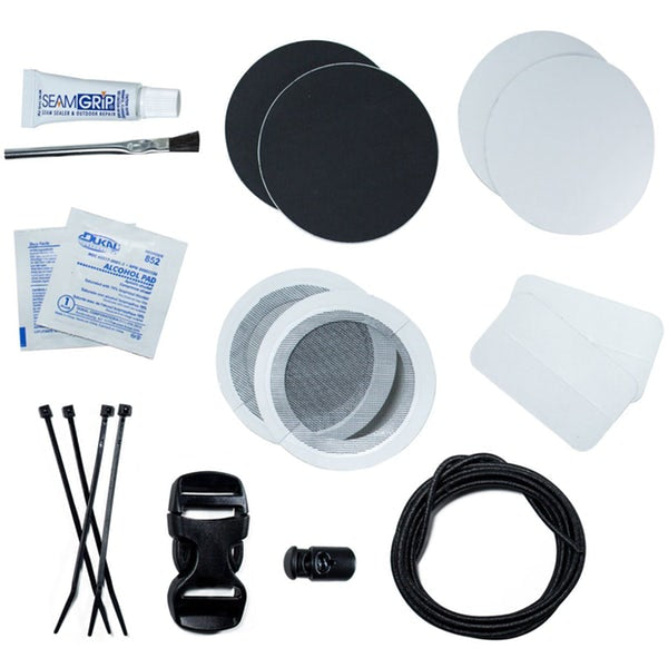 The contents of the Gear Aid Fix Anything Camp kit. Seam Grip, Alcohol Pads, Tenacious tape pads, a drawstring replacement, and cable ties.