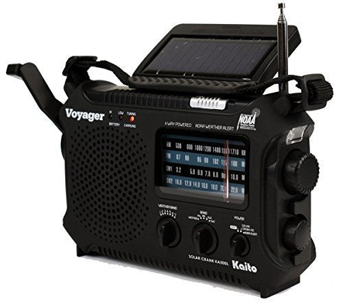 Kaito KA500 voyager radio in black with am, fm, sw, and NOA weather alert capable radio. The solar panel is point up to charge the device and the hand crank is shown.