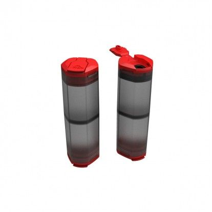 Mountain Safety Research Salt and Pepper shaker. The shakers are dual chamber meaning there are two compartments per shaker with red lids, the body of the shaker is a semi transparent black.