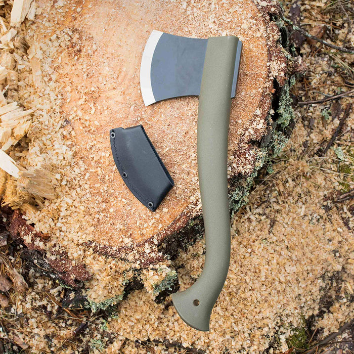 Morakniv Boron Camping Axe with Black leather Sheath on a stump covered in wood chippings. The axe shaft is an olive color and the blade is black with a stainless steel tip.