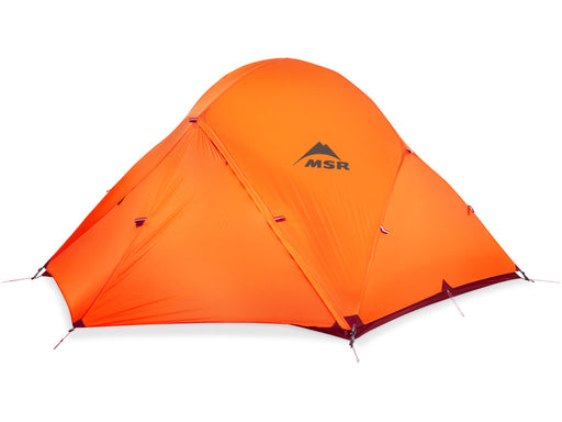 Weatherproof waterproof cover of the MSR 3-Person Access 4-season Tent. The cover is a brigh orange colour with the MSR logo printed in the middle.