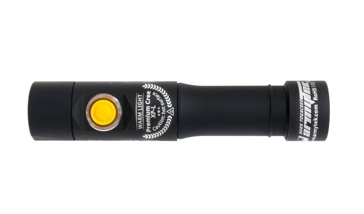 view of the armytek prime c2 flashlight showcasing the yellow power button and 'warm light premium cree xp-l' description