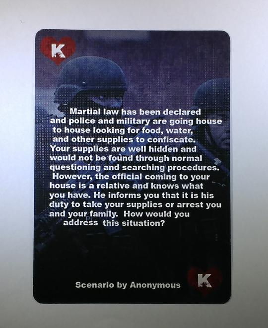 The King card from the Conflicted Survival Scenarios Deck #2. A swat team member is shown on the card and the card descriptions reads about Martial law being declared.