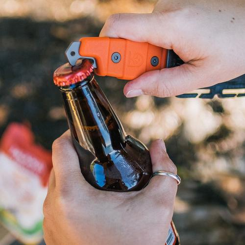 Buri Adventure knife's bottle opener being used to open a glass bottled beverage.