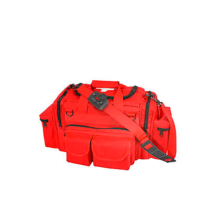 A Bright Red duffle bag with a Guardian Angel Personal Safety lighting bar mounted on the shoulder strap.