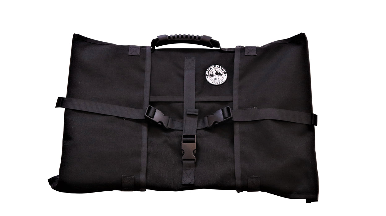 The Tactical Black Bug Out Roll with black hard plastic clips locked, the rubberized handle grip on top and the 'BugOut Roll' Logo patched on the front of the bag.