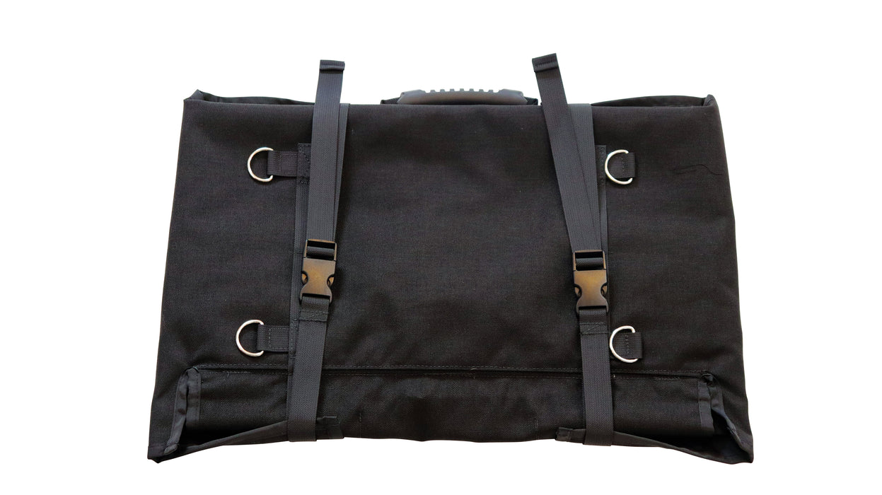 The back of the bugout roll with rope loops and two hard plastic belt clips holding the bag tightly closed.