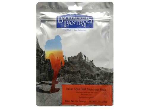Packet of 'Backpackers Pantry- Italian Style Beef Sauce Over Pasta' with a hiker site seeing over a canyon valley.