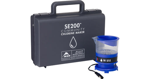 Mountain Safety Research Chlorine Based Purification Kit. The carrying case is a black hard plastic briefcase design and the chlorine maker is a royal blue.