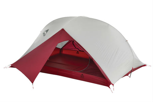 MSR Carbon Reflex Ultralight 3 Person tent. The Weather proof cover is placed on the tent body and the entry way is open in a deep red color. Other than the front entry, the tent is a grey color.