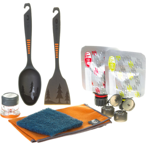 GSI Outdoors Kitchen Essentials pack with a spatula, large cooking spoon, salt & pepper shakers, cleaning rag, drying towel, and two swappable condiment pouches.