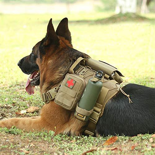 A german shepherd taking a break laying ont he ground with the Mill-Spex k-9 Tactical Molle Dog vest on. A first aid kit is attached to the vest with a green water bottle. The dog is laying on grass in a park during the day.
