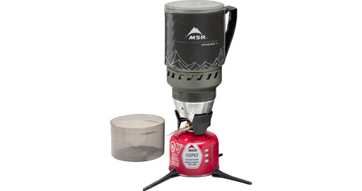 MSR WindBurner stove system with lock on pot, ISOPRO propane tank, and a measuring cup. the pot is a black colour with outlines of a mountain in white.