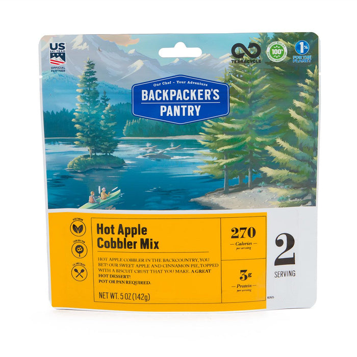 Freeze dried bag of backpackers pantry hot apple cobbler mix with descriptions '270 calories' '3 grams of protein' and '2 servings.' The package has a beautifully drawn image of 2 people in a 2 person kayak sighting seeing.