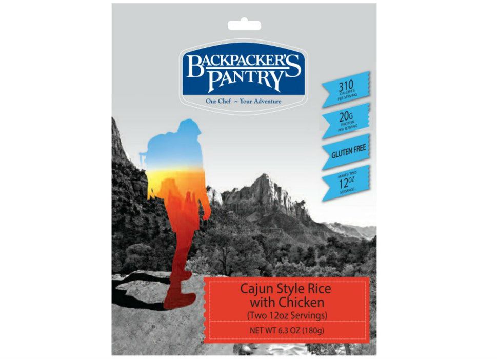 Backpackers Pantry - Cajun Style Rice and Chicken package front cover. Descriptions read '310 calories' '20 grams of protein' and 'gluten free.'  The cover also shows a hiker looking across the valley at a canyon face.