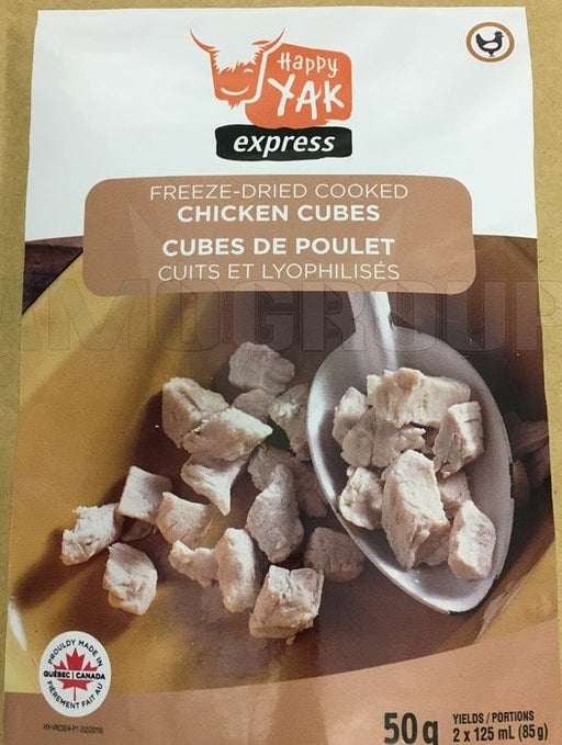 Package of Happy Yak Express Freez-Dried Cooked Chicken Cubes. The label 'Proudly made in Quebec Canada' is on the front cover with a picture of a spoon scooping the freeze dried chicken bits out of a mustard coloured bowl..