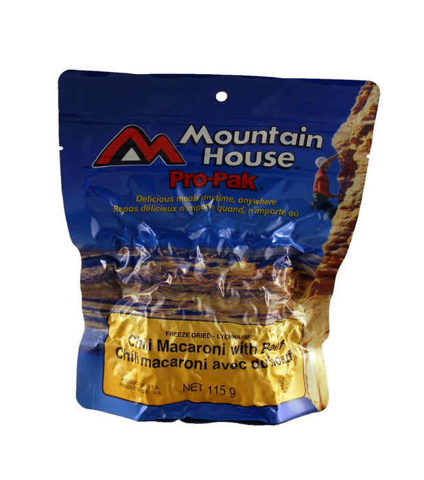 Mountain House Pro Pak of Chili Macaroni with Beef vacuum sealed package. On the cover is a climber wearing a red shirt and white helmet climbing a canyon rock face in the sun.