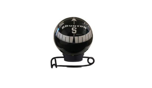 Brunton Mini Globe Compass attached on a pin in black with a reflective clear bulb.