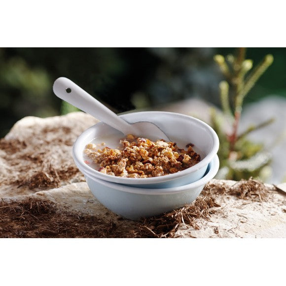 A bowl of Happy Yak Apple Cinnamon Freeze dried food with milk in a camping bowl with foon.