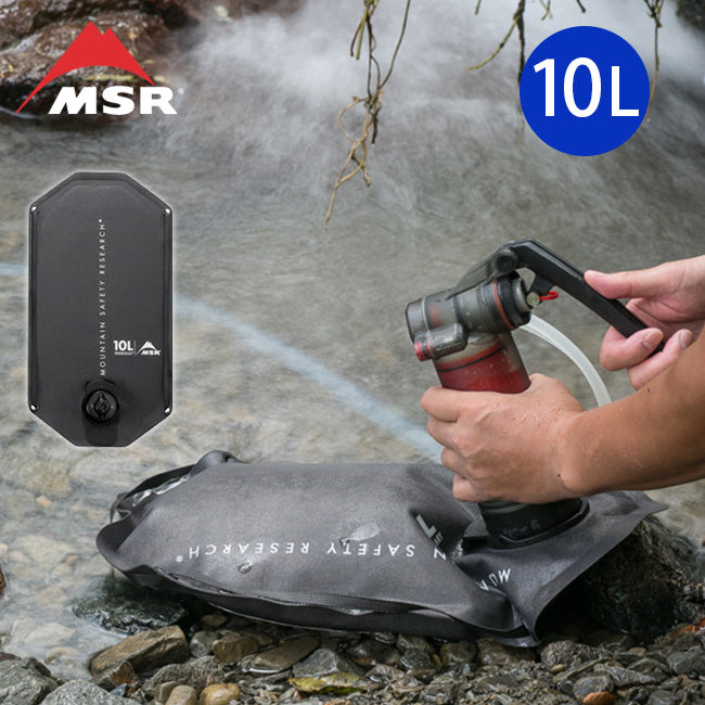 A person using the MSR Guardian Water Purifying system to fill a Rugged water storage bag with creek water.