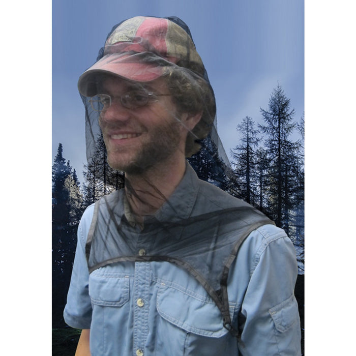 Man with glasses smiling and wearing the Ultranet Head Net over his hat outdoors.