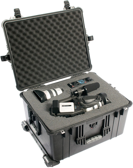 A video camera, video camera lens and a remote placed into the inside foam of a Pelican 1620 Protector case in black.