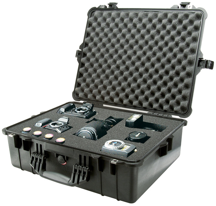 Two DSLR cameras with changeable lens's and extra film organized in the foam interior of the Pelican 1600 Protector Case.