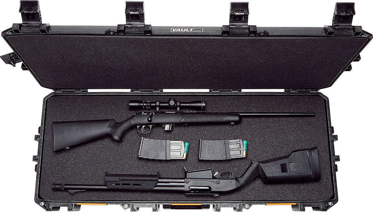 A sniper rifle with two magazines and an automatic shotgun in black paced in the foam liner of the Pelican V730 Tactical Gun Case.