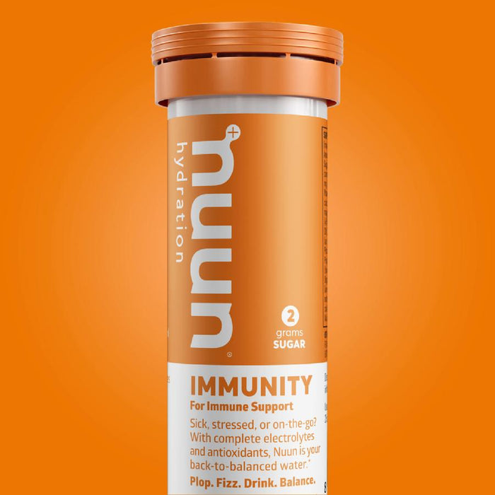 Nuun immunity boosting hydration tablets. 'Sick, stressed, or on the go? wWith complete electrolytes and antioxidants'. The canister is orange with white lettering.