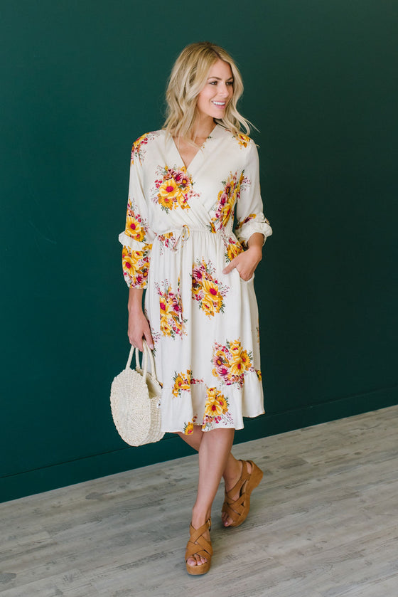 LEXI MIDI DRESS IN TAUPE WITH FLORAL DESIGN