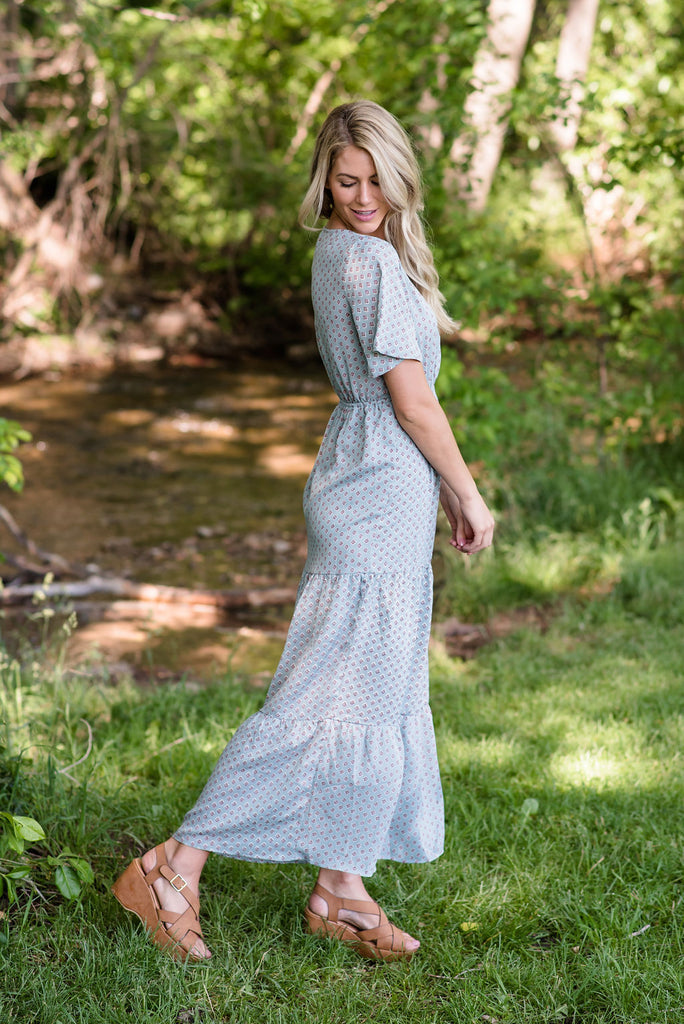 ELLA MAXI DRESS IN DUSTY BLUE WITH TIERED SKIRT
