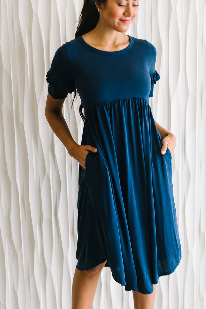 CALLIE MIDI DRESS WITH RUFFLE SLEEVES IN NAVY