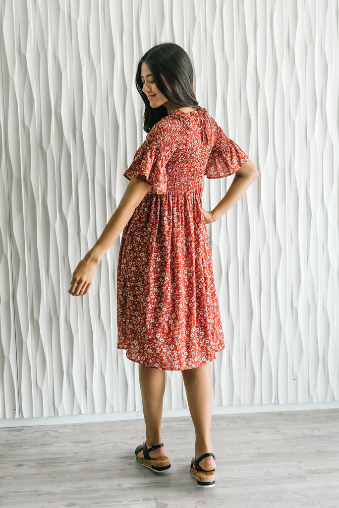 JULIETTE MIDI FLORAL DRESS IN RUST