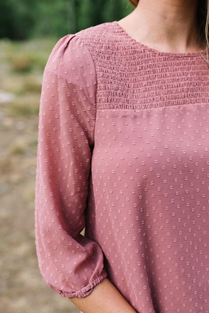 AMBER SWISS DOT TOP WITH SMOCKING DETAIL IN MAUVE