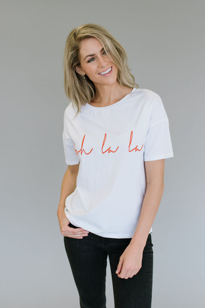 "WHITE TEE WITH ORANGE EMBROIDERED "" OOH LA LA """