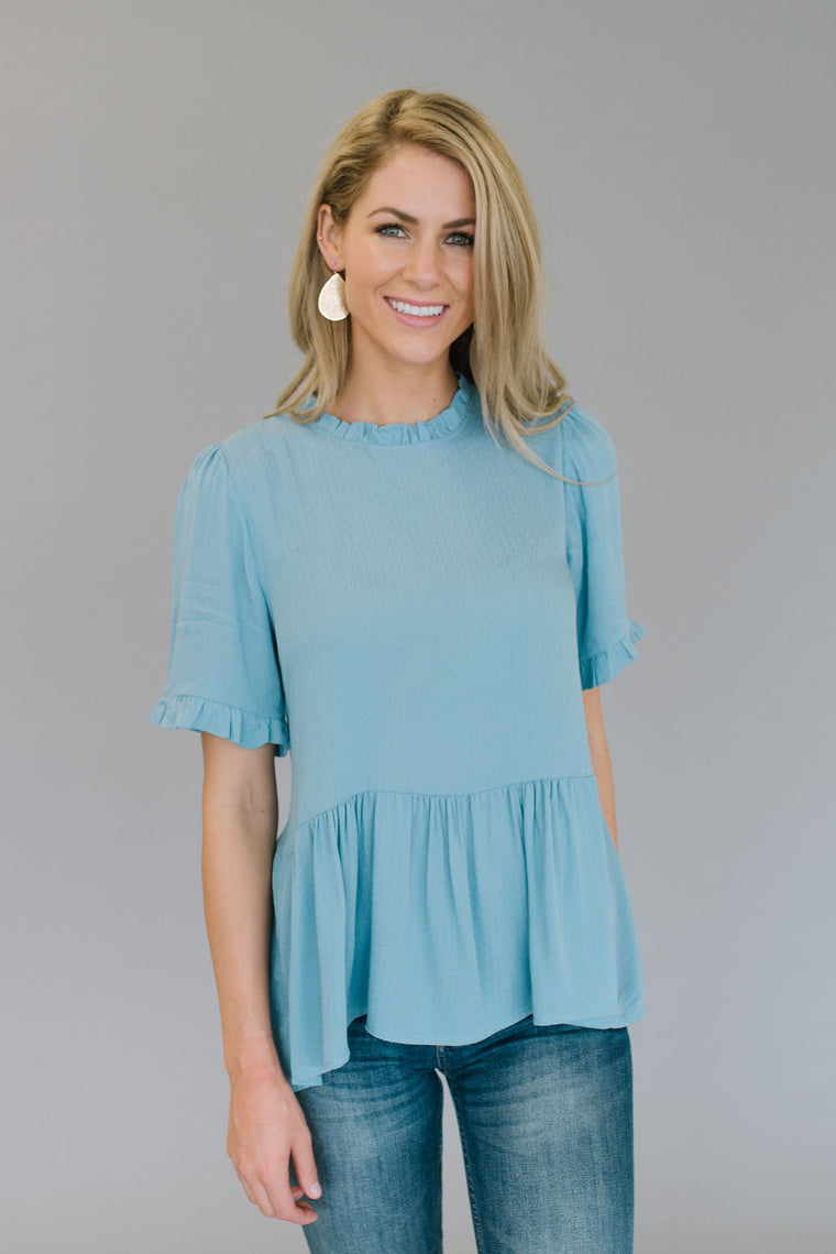 GRACE PEPLUM TOP IN ASH BLUE