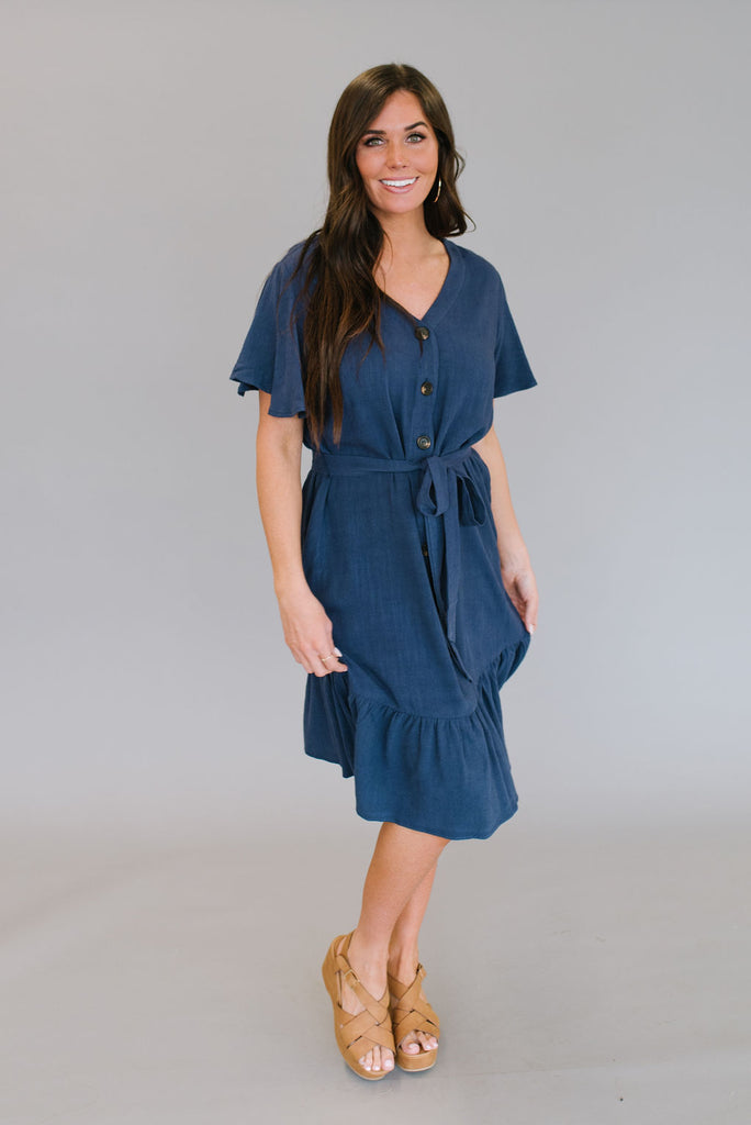 TAITE MIDI RUFFLE DRESS IN NAVY BLUE