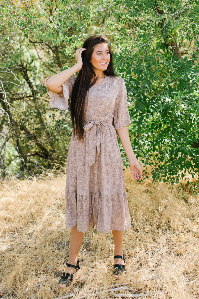IZZY FLOUNCY FIT AND FLARE MIDI DRESS IN TAUPE
