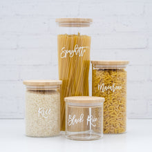 4 glass jar canisters with a bamboo lid