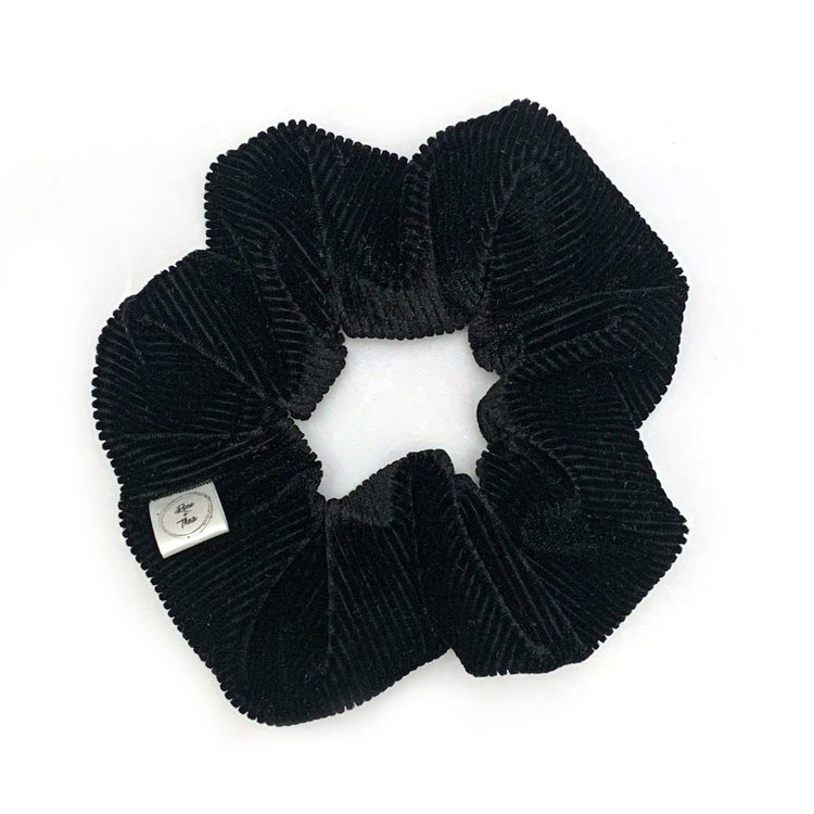 a handmade black velvet scrunchie by Rose and Thea