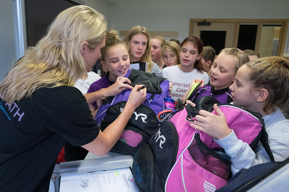 Olympic swimmer Jemma Lowe signs bag at our mobile swim shop