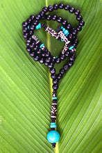 Tacca Necklace