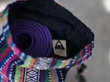 The Wild Guru yoga mat bag. Colorful geometric design. Insert pocket. 100% cotton. Adjustable strap.