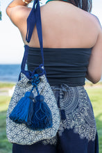 Boho Chic drawstring bag with blue tassels and geometric patterns