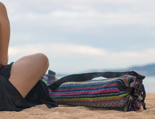 Wild Guru yoga mat bag on the beach. Colorful geometric design. 100% cotton. Adjustable strap.