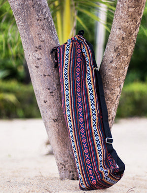 The Wild Guru yoga mat bag. Colorful geometric design. 100% cotton. Adjustable strap.